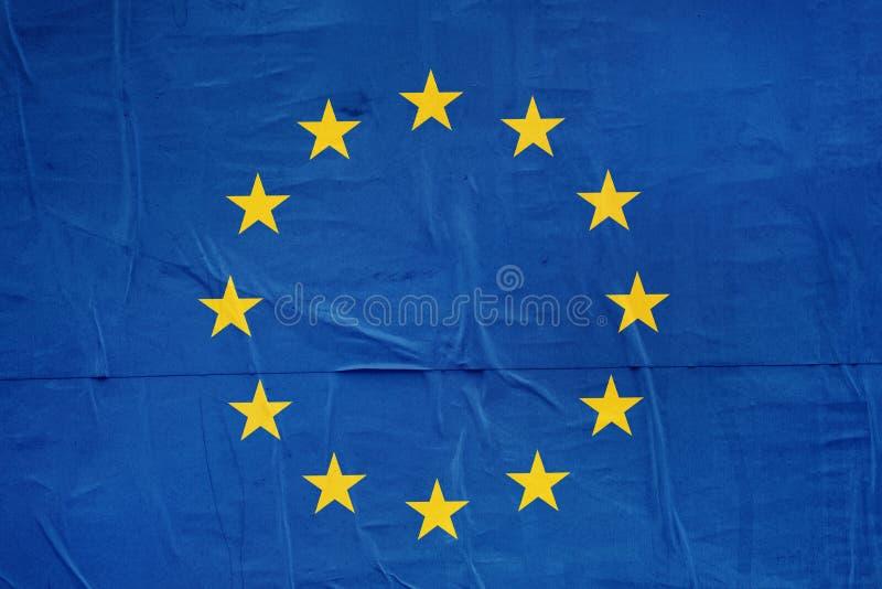 Impresión de la bandera de la UE en el papel de cartel del Grunge imagen de archivo