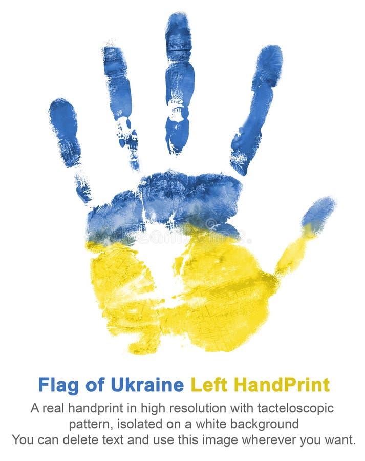 Impresión de la mano izquierda en las pinturas azules y amarillas, bandera de los colores de Ucrania imagen de archivo libre de regalías