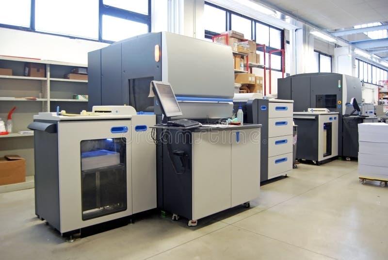Impresión en offset de Digitaces - prensa de cuatro colores imágenes de archivo libres de regalías