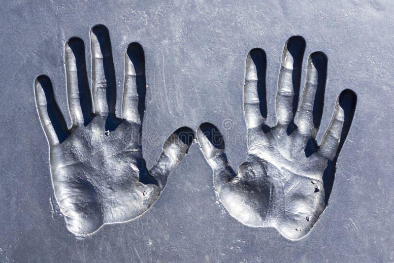 Impresiones de manos humanas fotografía de archivo