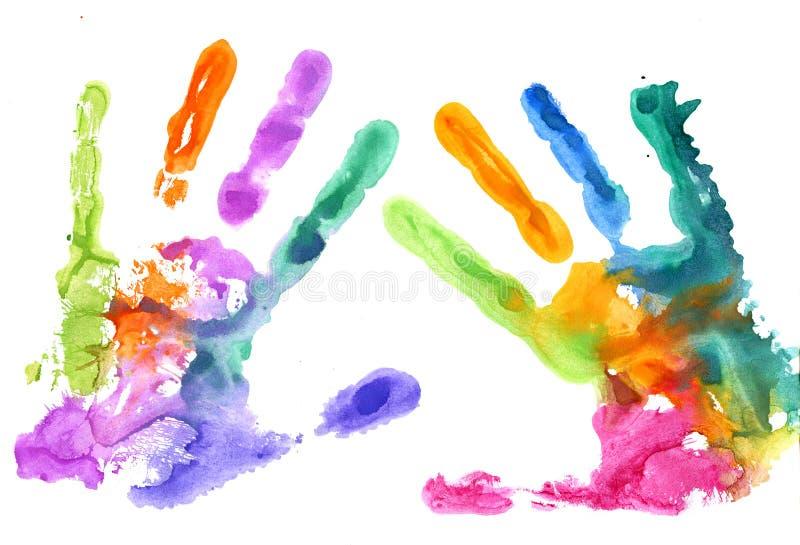Impresiones multicoloras de la mano en blanco imagen de archivo