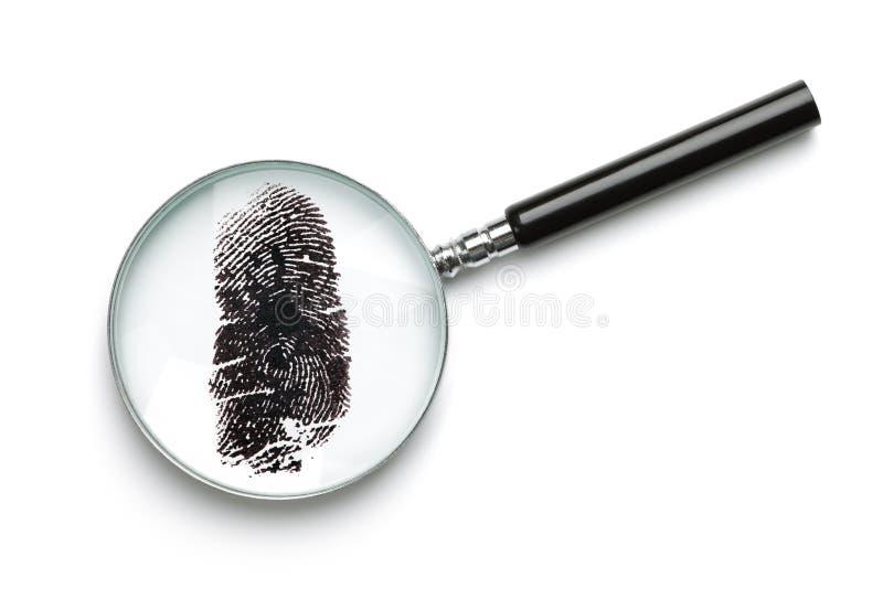 Impressão digital de exame da lupa fotografia de stock
