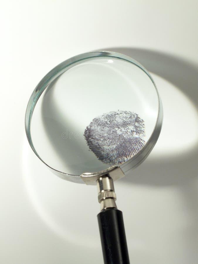 Impressão digital e magnifier imagem de stock royalty free