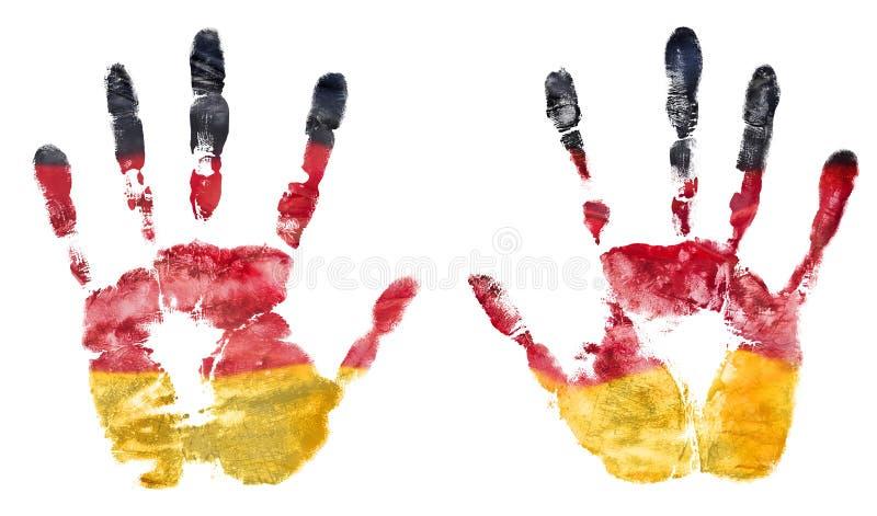 Impressão simbólica de duas mãos abertas da bandeira da pintura de Alemanha foto de stock royalty free