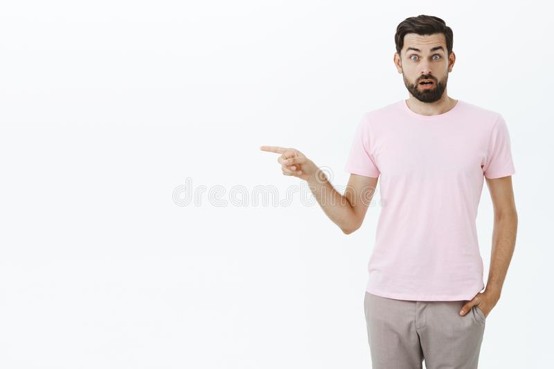 Impressed and shocked speechless questioned bearded 30s male with blue eyes open mouth from surprise and amazement royalty free stock photo