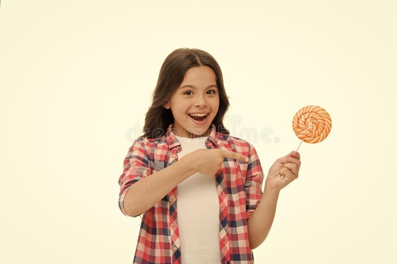 Impressing fact sugar nutrition. Girl child smiling holds lollipop candy. Girl kid with lollipop looks surprised. Healthy nutrition and dieting concept royalty free stock photos