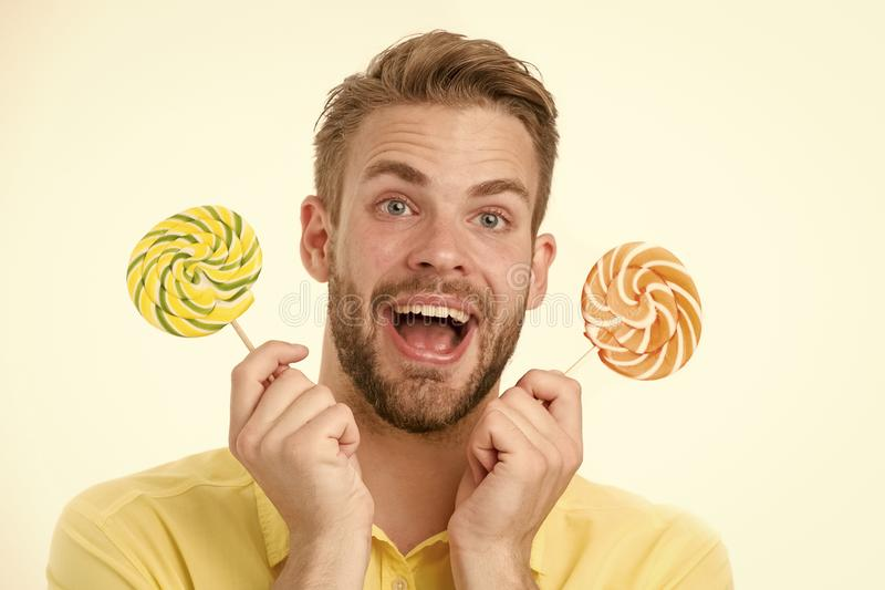 Impressing fact sugar nutrition. Man handsome bearded guy holds lollipop candy. Man with lollipop looks surprised royalty free stock photography