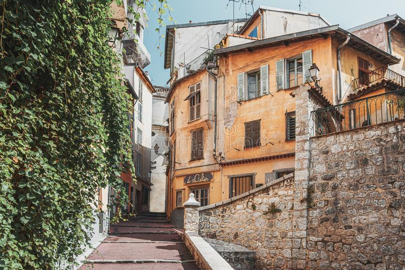 Impression of a narrow street in the old center of Nice in France royalty free stock image