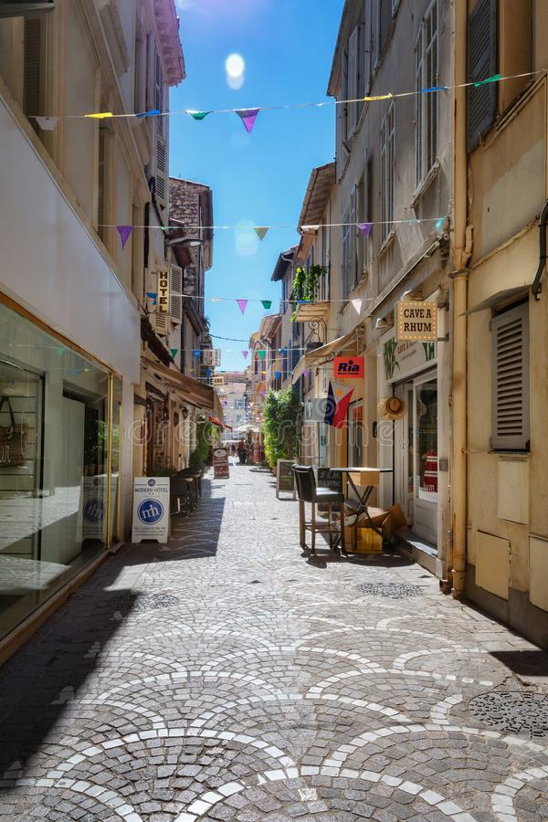 Impression of the narrow street Rue Fourmillière in the old center of Antibes. Antibes, France, September 11, 2018: Impression of the narrow street Rue royalty free stock photos