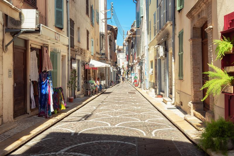 Impression of the narrow streets in the old center of Antibes. Antibes, France, September 11, 2018: Impression of the narrow streets in the old center of Antibes royalty free stock images