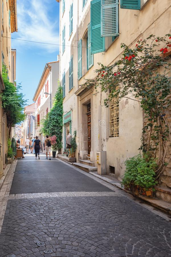 Impression of the narrow streets in the old center of Antibes. Antibes, France, September 11, 2018: Impression of the narrow streets in the old center of Antibes stock images
