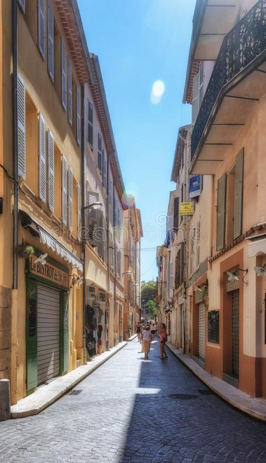 Impression of the narrow streets in the old center of Antibes. Antibes, France, September 11, 2018:  Impression of the narrow streets in the old center of stock photos