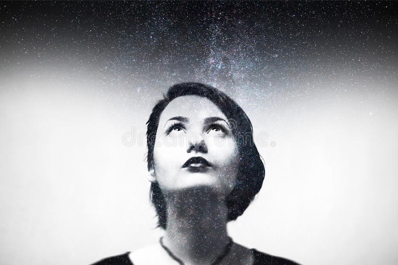 Impression portrait of young girl composition with night sky. stock images