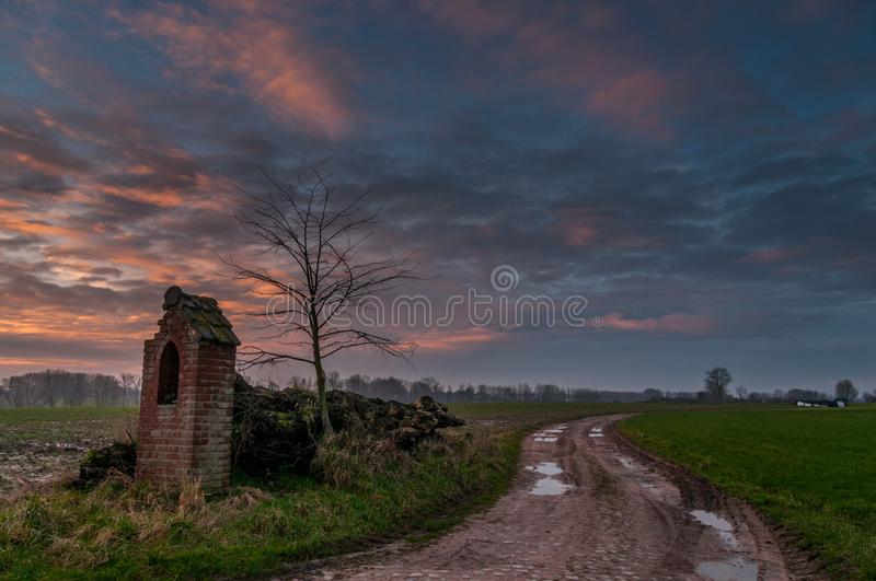 Sunrise over a country road. royalty free stock image