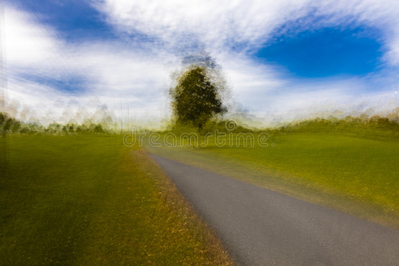 Impressionistic painterly view of Lone Tree and curved road/driveway in rural Virginia, October 26, 2016 stock image
