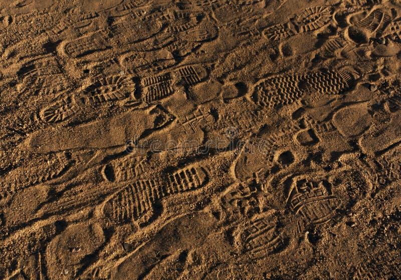 Impressions de pied sur le sable photos libres de droits