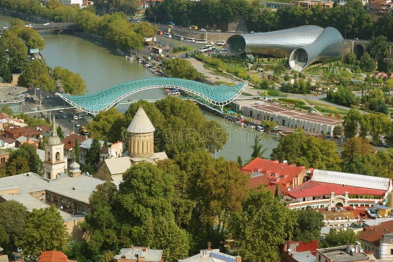 Impressive Aerial View with Peace Bridge and Tbilisi Concert Hall, the Iconic Landmarks of Tbilisi, Georgia. Amazing Architecture stock photo