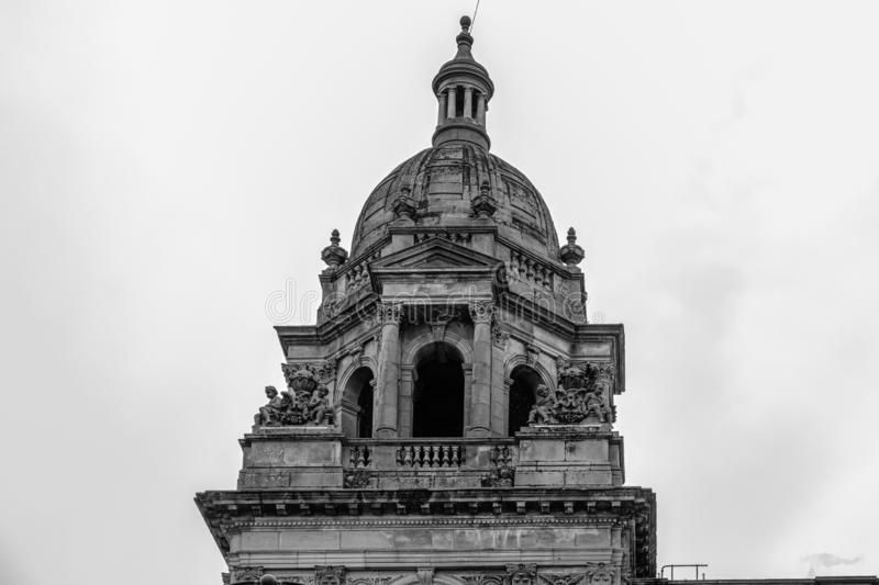 Impressive Architecture looking up to one of the Glasgow City Chambers Stone Steeples. Glasgow, Scotland, UK - June 22, 2019: Impressive Architecture looking up royalty free stock photography