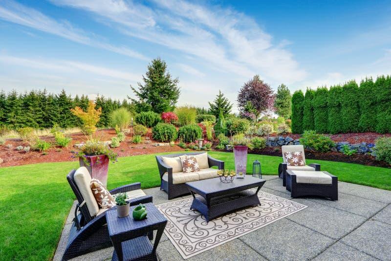 Impressive backyard landscape design with patio area royalty free stock image