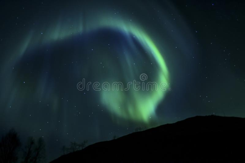 BLUE AURORA IN THE ARCTIC SKY stock images