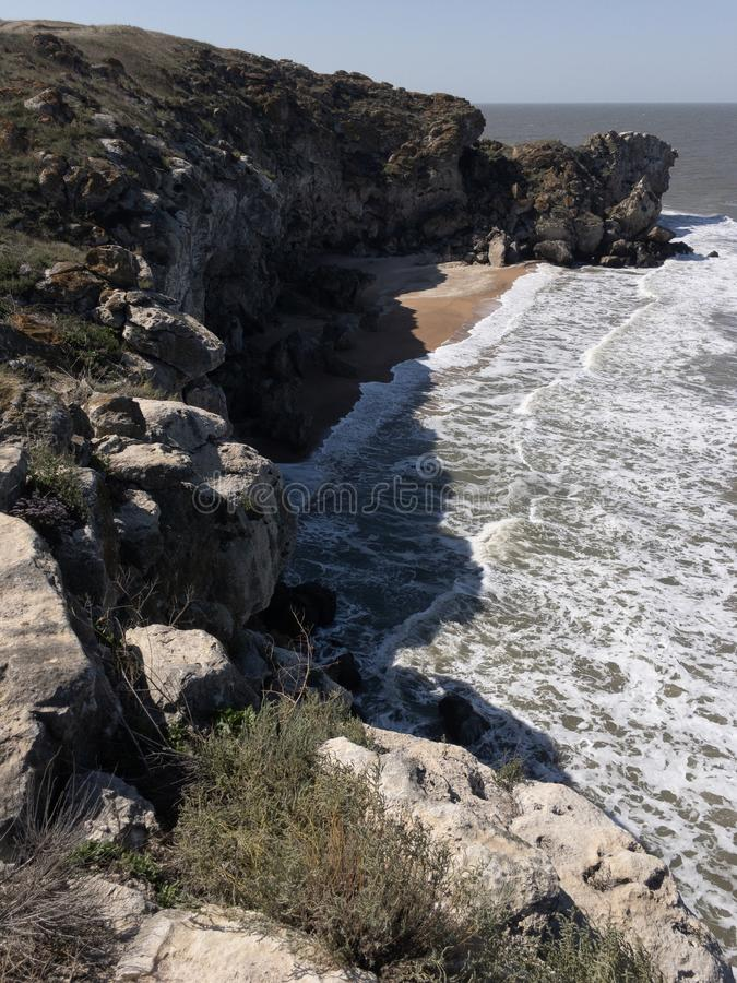 Impressive Crimean seascape with high cliffs and big sea waves. Copy space royalty free stock photo