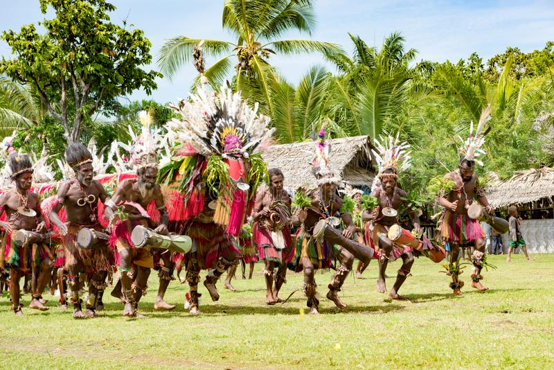 Impressive dragon dance ceremony, Kopar village, Sepik River, Papua New Guinea. Traditional dragon dance celebration in New Guinea on Sepik River royalty free stock images