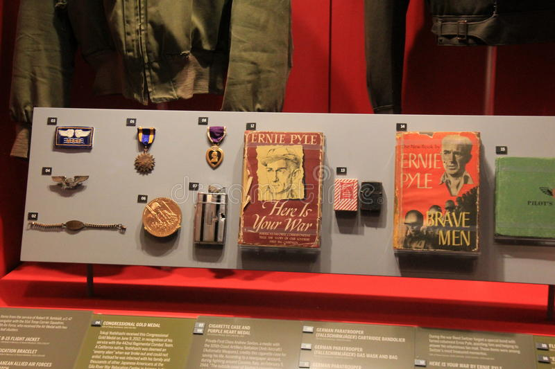 Impressive exhibit of soldier`s medals and books, National WWII Museum, New Orleans, 2016. Emotional exhibit depicting war medals and books belonging to soldiers royalty free stock photo