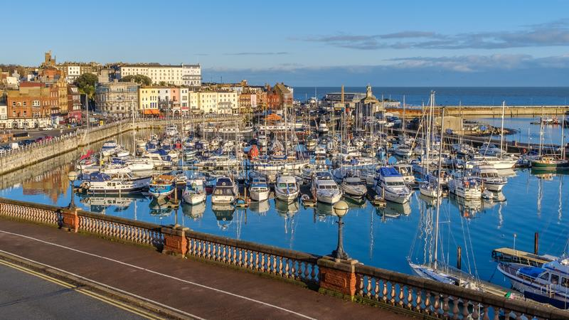 The impressive and historic Royal Harbour of Ramsgate, Kent, Uk, full of leisure and fishing boats of all sizes royalty free stock image