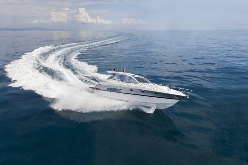 Motor boat making turn stock images