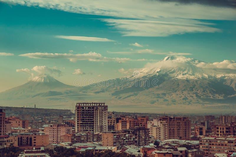 Impressive mount Ararat background. Yerevan cityscape. Travel to Armenia. Tourism industry. Cloudy sky. Armenian architecture. Cit. Y tour. Urban landscape stock photo