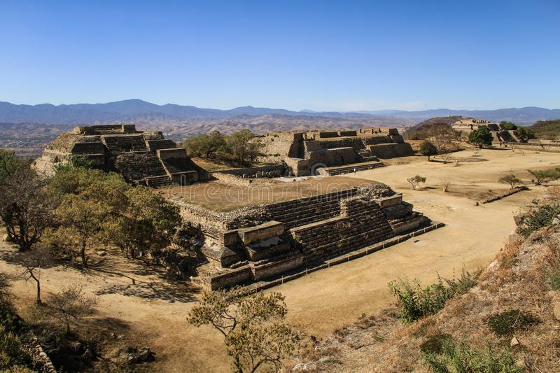 The impressive pre-Columbian archaeological site of Monte Alban, Oaxaca, Oaxaca State, Mexico. Monte Albán, likely originally called Danipaguache, is a large stock photography
