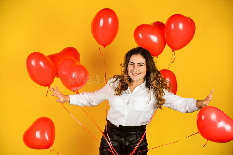 Impressive present. Happy valentines day. Birthday party. Helium balloons for party. Girl heart balloons. Festive mood stock photography