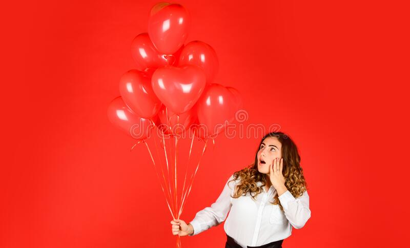 Impressive present. Happy valentines day. Girl heart balloons. Romantic love. Happy woman air balloons bunch gift royalty free stock photography