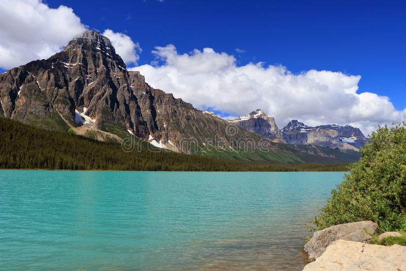 Mount Chephren and Turquoise Waterfowl Lake along the Icefields Parkway, Rocky Mountains, Banff National Park, Alberta, Canada. The impressive pyramid of Mount stock images