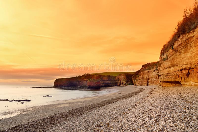 Impressive red sandstones of the Ladram bay on the Jurassic coast, a World Heritage Site on the English Channel coast of southern royalty free stock images