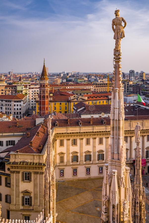 Vertical view from the Duomo di Milano rooftop at sunset. royalty free stock photography