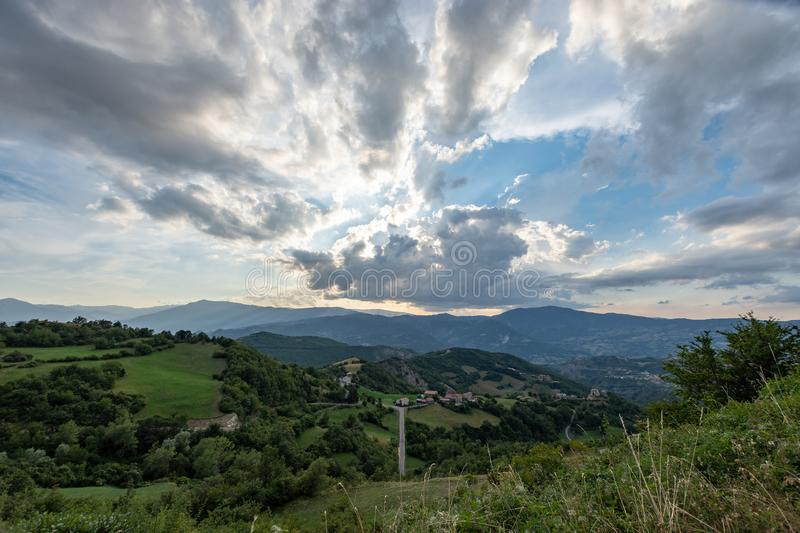 Impressive sunset over the saddle of the generals, a town above the city of Bobbio royalty free stock images