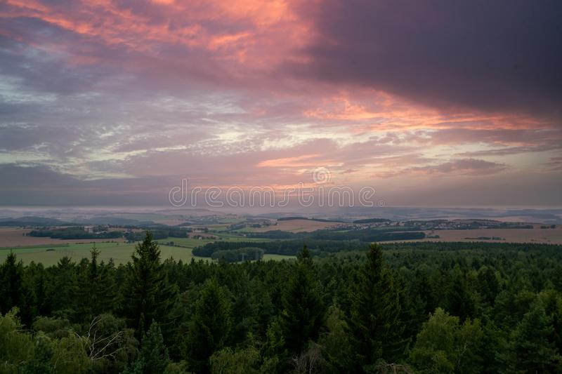 Impressive sunset in spring with forest royalty free stock photo