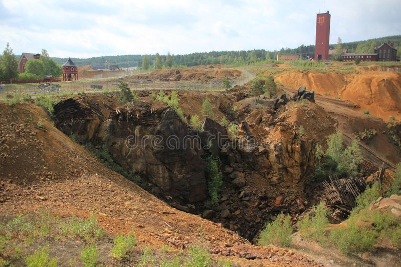 Old copper mine in Falun in Sweden. An impressive view over the great copper mine Unesco world heritage site in Falun in Sweden in the summer stock photos