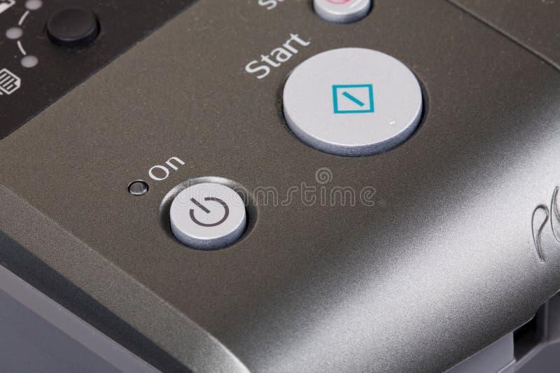 Imprimante sur le bouton image stock