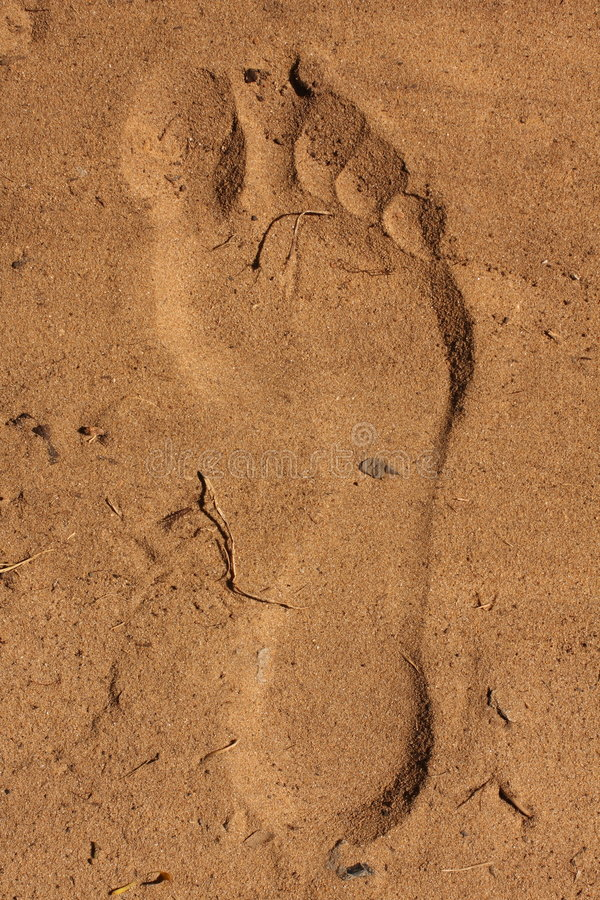 Imprint do pé na areia fotos de stock royalty free