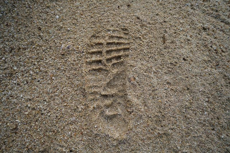 Imprint of the shoe on sand royalty free stock photo