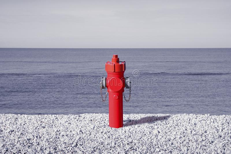 An improbable hydrant at the seaside. Plenty of water concept image stock photos