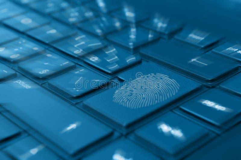 Impronta digitale sulla tastiera del taccuino fotografia stock