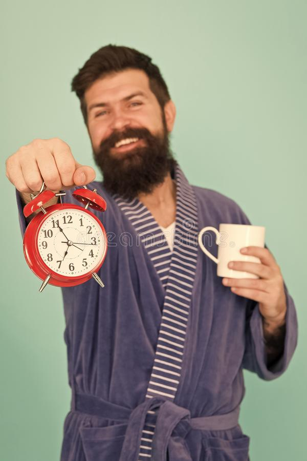 Improve my morning routine. hard morning. hipster drink morning coffee. bearded man coffee cup. wakeup time. early stock photography