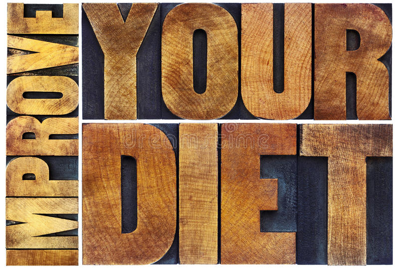 Improve your diet letterpress typography. Improve your diet - healthy lifestyle concept - isolated word abstract in vintage letterpress wood type printing blocks stock photos