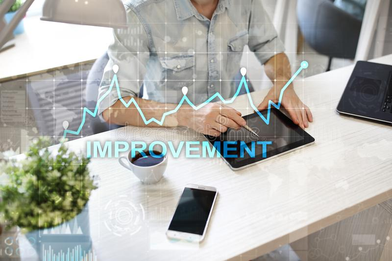 Improvement graph on virtual screen. Business and technology concept. stock images