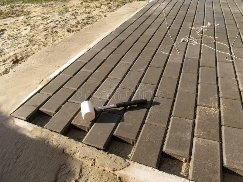 Improvement of sidewalk paving slabs, street design stock images