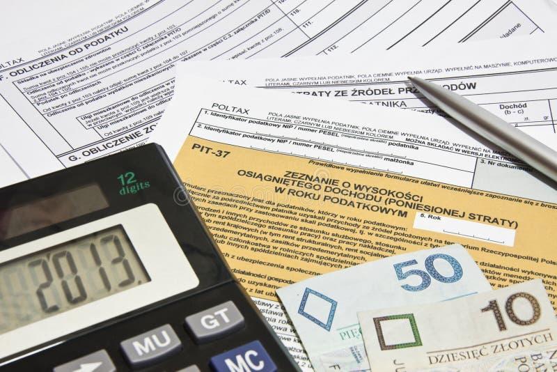 Impuestos calculadores en Polonia fotos de archivo libres de regalías