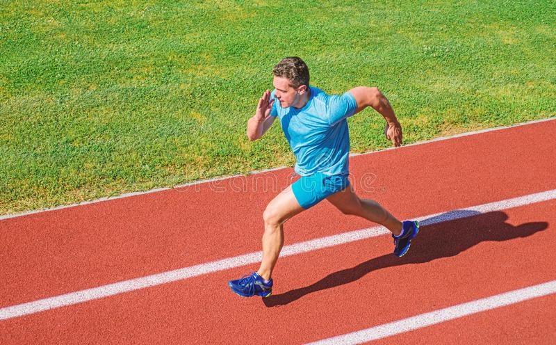 Impulse to move. Athlete run stadium green grass background. Life non stop motion. Runner sporty shape in motion. Sport. Lifestyle and health concept. Man stock photos